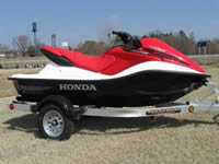Image of a nice red 2006 Honda Aquatrax F12 Waverunner
